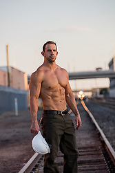 shirtless muscular construction worker outdoors