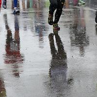 (Newton, MA - 4/20/15) Runners climb Heartbreak Hill in the rain during the Boston Marathon, Monday, April 20, 2015. Staff photo by Angela Rowlings.