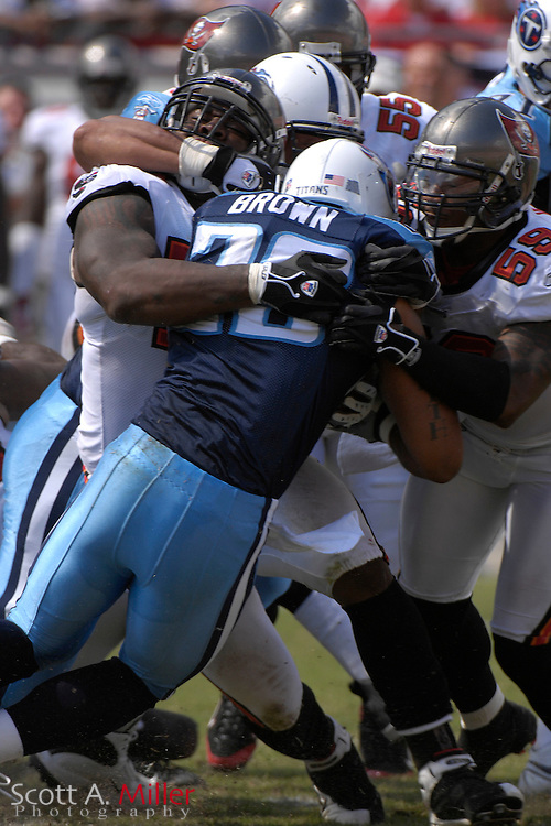 Oct. 14, 2007; Tampa, FL, USA; Tennessee Titans running back (29) Chris Brown is stopped by the Tampa Bay Buccaneers defense after a short gain during the first half of his team's game against the Buccaneers at Raymond James Stadium. ...©2007 Scott A. Miller