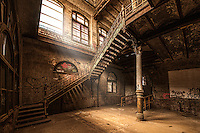 An old iron staircase winds up seven stories through the old abandoned Tennessee Brewing Company in Memphis.