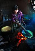 A woman in a kitchen in eastern Bhutan.