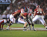 Ole Miss defensive end Gerald Rivers (90) sacks Alabama quarterback Greg McElroy (12) at Bryant-Denny Stadium in Tuscaloosa, Ala.  on Saturday, October 16, 2010. Alabama won 23-10.