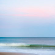 "I made visits to the beach recently to try and practice the art of incorporating motion into still seascapes.  The evening presented with pale pastels at dusk, giving my frame some pinks and purples to hold on to.  I think I've got the hang of it, and I started to even incorporate more beach into the frame.  Now I just have to find more variety and try this technique during stormy gray days, brilliant sunny days, with super long ""strokes"" with the camera, shorter exposures with people within the frame...  The possibilities are endless!"