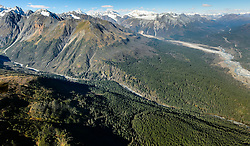 Constantine Metal Resources Ltd. of Vancouver, British Columbia along with investment partner Dowa Metals &amp; Mining Co., Ltd. of Japan is exploring a potential site for a mine (located on the upper left side of image) just above Glacier Creek (foreground) and the Klehini River (right side of image). The border with British Columbia is at the upper right. The area above Glacier Greek, known as the Palmer Deposit is located near mile 40 of the Haines Highway.<br /> <br /> The minerals that Constantine&rsquo;s drilling explorations have found are primarily copper and zinc, with significant amounts of gold and silver. Exploratory drilling to refine the location and mineral amounts are the current focus of the company.<br /> <br /> If approved and developed, the mine, near Haines, Alaska would be an underground mine. Besides the actual ore deposits, having the nearby highway access for transporting ore to the deepwater port at Haines is also attractive to Constantine. The Haines Highway can be seen in photo on the right.<br /> <br /> Support for a large scale mine such as the Constantine project is divided among residents of Haines, a small community in Southeast Alaska 75 miles northwest of Juneau. The community&rsquo;s needed economic boost from jobs, development and other mine support that a large-scale mine brings is tempting to some. To others, anything that might put the salmon spawning and rearing habitat and watershed resources at risk is simply unimaginable and unacceptable. Of particular concern is copper and other heavy metals in mine waste leaching into the Klehini River (shown) and the Chilkat River 14 miles downstream. Copper and heavy metals are toxic to salmon and bald eagles.<br /> <br /> The Chilkat River chum salmon are the primary food source for one of the largest gatherings of bald eagles in the world. Each fall, bald eagles congregate in the Alaska Chilkat Bald Eagle Preserve, located only three miles downriver from the area of current explorati