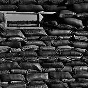 Jul 15, 2008 - Zhari District, Kandahar Province, Afghanistan - A sand bag fighting position and gun port looking in the direction of Sangasar ( aka Singisar )above a bunker at a Canadian Forward Operating Base ( FOB ) in Zhari District, Afghanistan. Sangasar is believed to the birthplace of the Taliban movement, led my Mullah Mohammed Omar. This district is one of the most contested areas in the country..(Credit Image: © Louie Palu/ZUMA Press)..