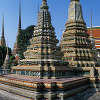 Asia, Thailand, Bangkok, Ornate spires of chedis on grounds of Wat Pho, the oldest and largest Buddhist temple in the city