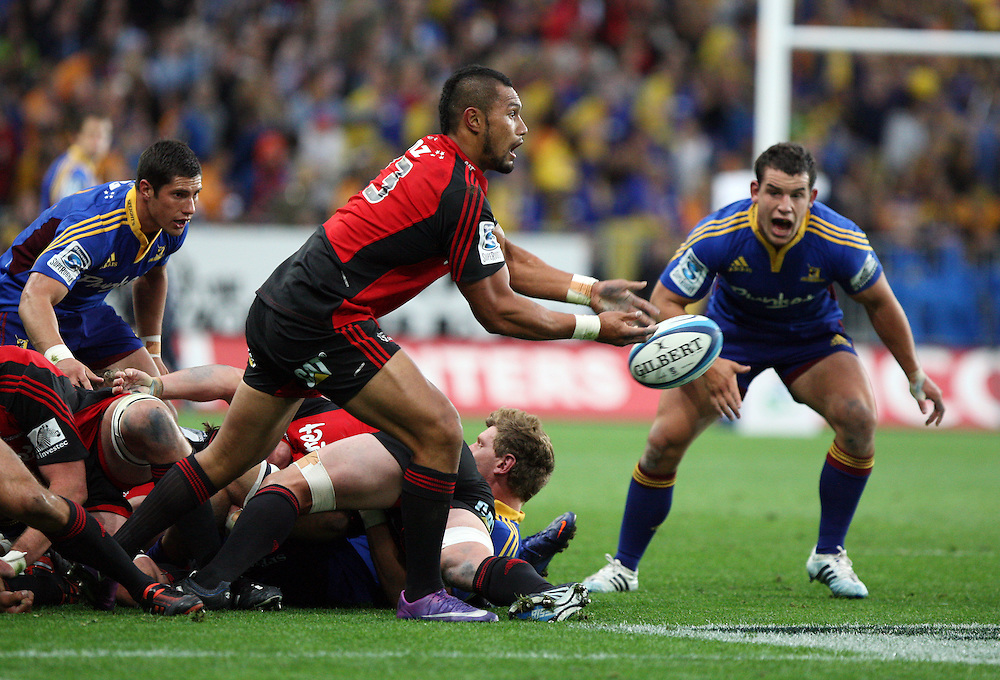 Crusaders's Robbie Fruean gets the ball away against the Highlanders in the Super 15 rugby match at Forsyth Barr Stadium, Dunedin, New Zealand, Saturday, March 03, 2012. Credit:SNPA / Dianne Manson