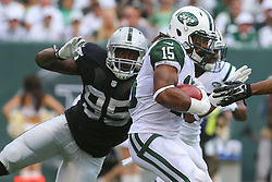 EAST RUTHERFORD, NJ - SEPTEMBER 7: Saalim Hakim (15) of the New York Jets avoids a tackle attempt by Kaelin Burnett (95) of the Oakland Raiders at MetLife Stadium on September 7, 2012 in East Rutherford, NJ.  (Photo by Ed Mulholland/Getty Images) *** Local Caption *** Saalim Hakim; Kaelin Burnett