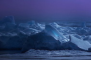 Located 1200 Km from the North Pole, the icy landscape of Kongsøya in the arctic archipelago of Svalbard, takes on a surreal hue in the polar dusk.