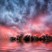 Photoshop Flaming Pear Flood filter applied to storm clouds at sunset in Concan, Texas in spring.