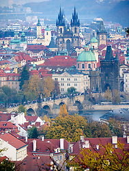 View from Petrin to Stare Mesto with Charles Bridge in middle distance in Prague in Czech Republic