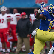 Delaware running back WES HILLS (31 ) rushes for extra yards during a game between the Delaware Blue Hens and the Stony Brook Seawolves, Saturday, Oct. 22, 2016 at Tubby Raymond Field at Delaware Stadium in Newark, DE.