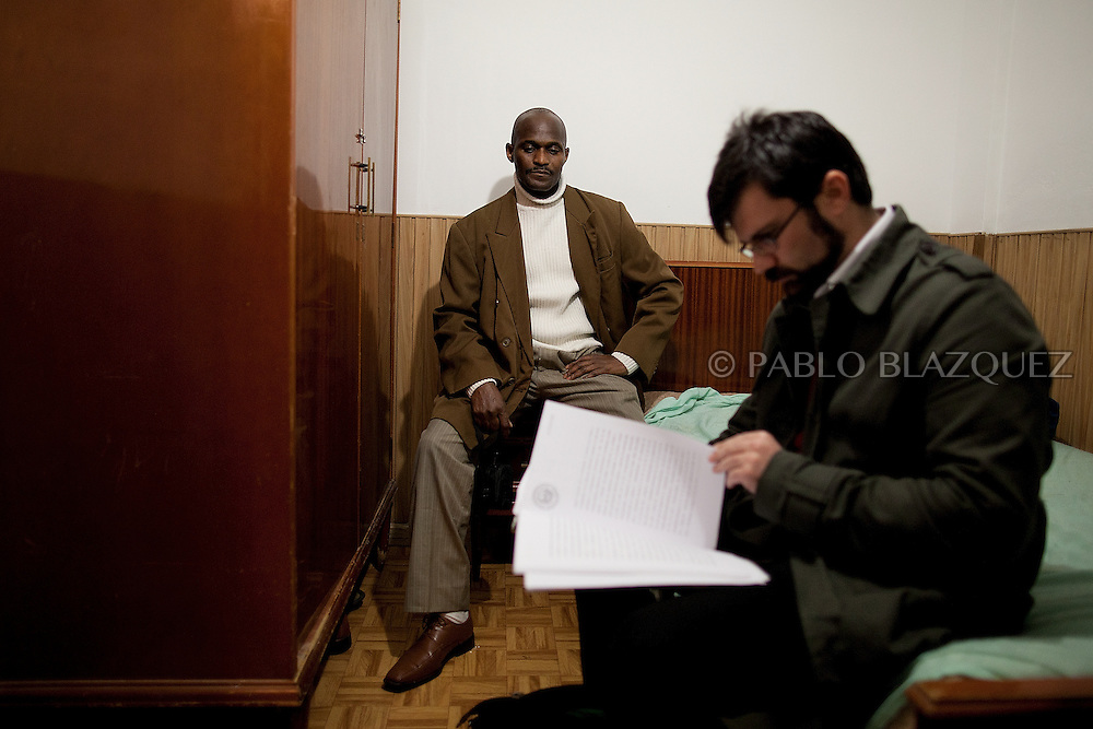 Luis Mendes (L) double checks court papers with his lawyer in the morning before he faces eviction from his home on January 10 of 2011 in Torrejon de Ardoz, Madrid, Spain. .Luis Mendes is currently an unemployed builder, 45 years old, from Guinea Bissau, and has a wife and 8 children to maintain in Senegal. He lives at his home in Torrejon De Ardoz, Madrid, with his brothers. .Today he is facing a second eviction attempt as he stopped paying the mortgage to Bankia Bank when lost his job in 2009 during the economic crisis. He had to choose between feeding his children or paying the bank. At the moment, he cannot even send money anymore to his family and if he losses his current house, he would gain a live-long debt. He has tried to negotiate with the bank to reach a different solution, by paying a lower monthly fee, but up to now there was no agreement for it..This is also case of many people in Spain that are losing their homes every-days and also gaining debts to banks..According to details of the General Council of the Judiciary, in Madrid there are 40 evictions every-days.