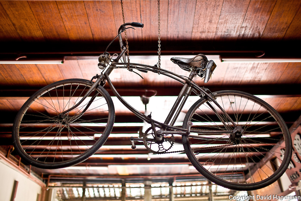 an antique bicycle hangs from the ceiling of Uncle Soon (Fong Ching Soon's) shop, Armenian St.