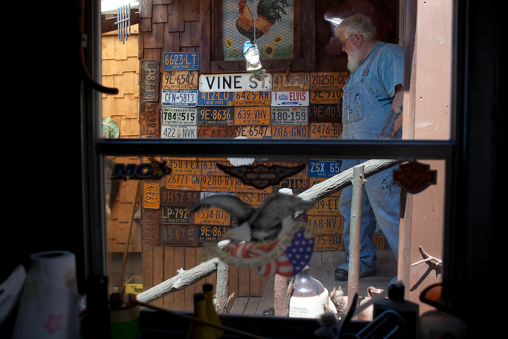 Ernie Rose shows off his collection of New York State license plates at his home in Lockport, NY, on Thursday, July 30, 2009.