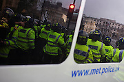 Met Police riot officers form a kettle to keep protesting students from escaping from Trafalgar Square.