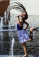 A girl cools off in the fountain at Grand Park downtown Los Angeles Friday March 13, 2015. High temperatures in the 80s and 90s were recorded Friday, and Southern California could see record-breaking high temperatures over the weekend.