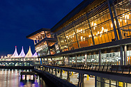 View of the Vancouver Convention Center (looking east) and Canada Place (Vancouver Convention Centre East) in the evening.  Photographed from Coal Harbour in Vancouver, British Columbia, Canada.
