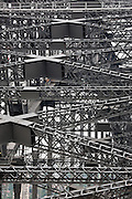 """Detail of the Sydney Harbour Bridge steel truss Structure Sydney, Australia. The Sydney Harbour Bridge is a steel through arch bridge across Sydney Harbour that carries rail, vehicular and pedestrian traffic between theSydney central business district (CBD) and the North Shore. The dramatic view of the bridge, the harbour, and the nearby Sydney Opera House is an iconic image of both Sydney and Australia. The bridge is locally nicknamed """"The Coathanger"""" because of its arch-based design...The bridge was designed and built by Dorman Long and Co Ltd, Middlesbrough Teesside and Cleveland Bridge, Darlington, County Durham and opened in 1932. Until 1967 it was the city's tallest structure.[citation needed] According to Guinness World Records, it is the world's widest long-span bridge and it is the tallest steel arch bridge, measuring 134 metres (440 ft) from top to water level. It is also the fifth-longest spanning-arch bridge in the world."""