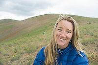 Portrait of a Amy McGuire while on a Springtime backpacking trip on Umptanum Ridge in Eastern Washington, USA.