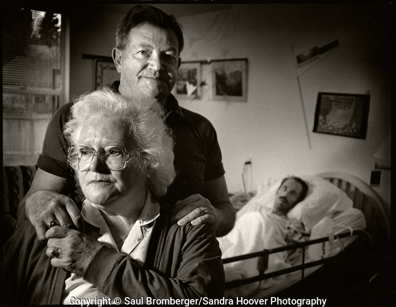 A documentary photo essay about some of the men and women living and battling the ravaging and horrific effects of AIDS, at the Bailey-Boushay House, an AIDS Hospice, in Seattle, WA., from June 1992 to April 1995.<br /> <br /> Opened in June 1992, B.B.H. was developed by AIDS Housing of Washington as the first new nursing care residence and day health program in America for HIV/AIDS patients.<br /> <br /> Our purposes were to humanize AIDS, to compel the viewer to say &quot;this could be me,&quot; and to educate those who did not see the disease and its victims face to face; and, to show the dignity and loving care that the B.B.H. community - the staff, volunteers, and families - provided to people living with AIDS in their final stages of life. &quot;It provides a respectful place for a major passage in life,&quot; said Administrator Christine Hurley.<br /> <br /> It gave us immense satisfaction that the portraits gave many of the clients a new sense of self esteem as they still felt worthy and important to be photographed, and that they trusted us to tell their story and share it.<br /> <br /> * To see more images from this project please go to the Archive section, and then to Galleries.