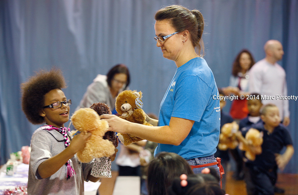 SHOT 12/15/14 6:32:35 PM - Medical Center of Aurora Executive Team members and Directors volunteered their time serving dinner and handing out gifts and toys at the Denver Broncos Boys & Girls Club in Montbello Monday evening. (Photo by Marc Piscotty / © 2014)
