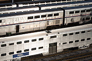 Lines of Metra and Amtrak passenger cars await the rush hour in the yards in Chicago, IL.
