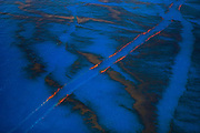 Paths of oil-free water remain in the calm waters of the Gulf of Mexico from boats attempting to clean up the crude spill off the coast of Louisiana, June, 2010.