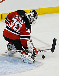 Apr 15, 2009; Newark, NJ, USA; New Jersey Devils goalie Martin Brodeur (30) makes a save during the second period of game one of the eastern conference quarterfinals of the 2009 Stanley Cup playoffs against the Carolina Hurricanes at the Prudential Center.