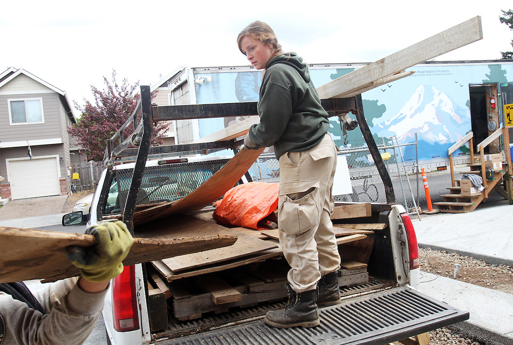 Cydne Romine, an Americorps volunteer...John Gray was born 92 years ago and grew up poor in rural Oregon. He made a fortune in the chainsaw industry after World War II, and now he has donated more than a million dollars to Habitat for Humanity to buy land in Portland for low-income housing. Volunteers work to build solid foundations on the largest of these land parcels on Wednesday, May 2, 2012.