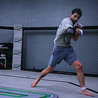 Jackson's/Winklejohn's: January 23, 2012 UFC fighter Carlos Condit shadow boxes in the cage after coach Jackson's class at Jackson's/Winkeljohn's in Albuquerque, NM