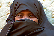 KENYA, LAMU ISLAND veiled Swahili girl in town on Lamu Island