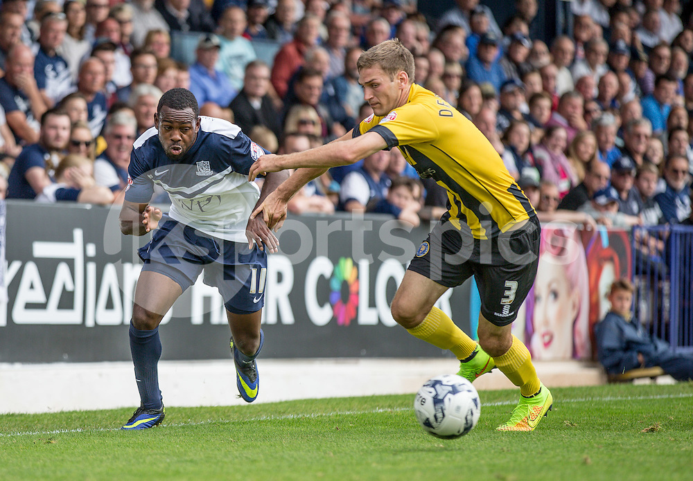 Myles Weston of Southend Utd and Mickey Demetriou of Shrewsbury Town during the Sky Bet League 2 match between Southend United and Shrewsbury Town at Roots Hall, Southend, England on 27 September 2014. Photo by Liam McAvoy.