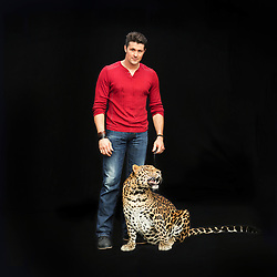 Portrait of Alexander Lacey and his leopard Mogli. <br /> <br /> Ringling Bros. and Barnum &amp; Bailey Circus started in 1919 when the circus created by James Anthony Bailey and P. T. Barnum merged with the Ringling Brothers Circus. Currently, the circus maintains two circus train-based shows, the Blue Tour and the Red Tour, as well as the truck-based Gold Tour. Each train is a mile long with roughly 60 cars: 40 passenger cars and 20 freight. Each train presents a different &quot;edition&quot; of the show, using a numbering scheme that dates back to circus origins in 1871 &mdash; the first year of P.T. Barnum's show.