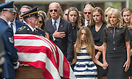 Vice President Joseph Biden places his hand on his heart as the casket of his son Beau is moved, by military honor guard, into St. Anthony of Padual Catholic Church in Wilmington, De., Saturday, June 6, 2015.  Standing with the Vice President is his granddaughter Natalie and wife Dr. Jill Biden.  Reuters/Bryan Woolston.