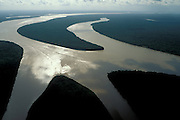 Aerial of islands in Amazon estuary near Marajó Island, Pará, Brazil, in late afternoon.