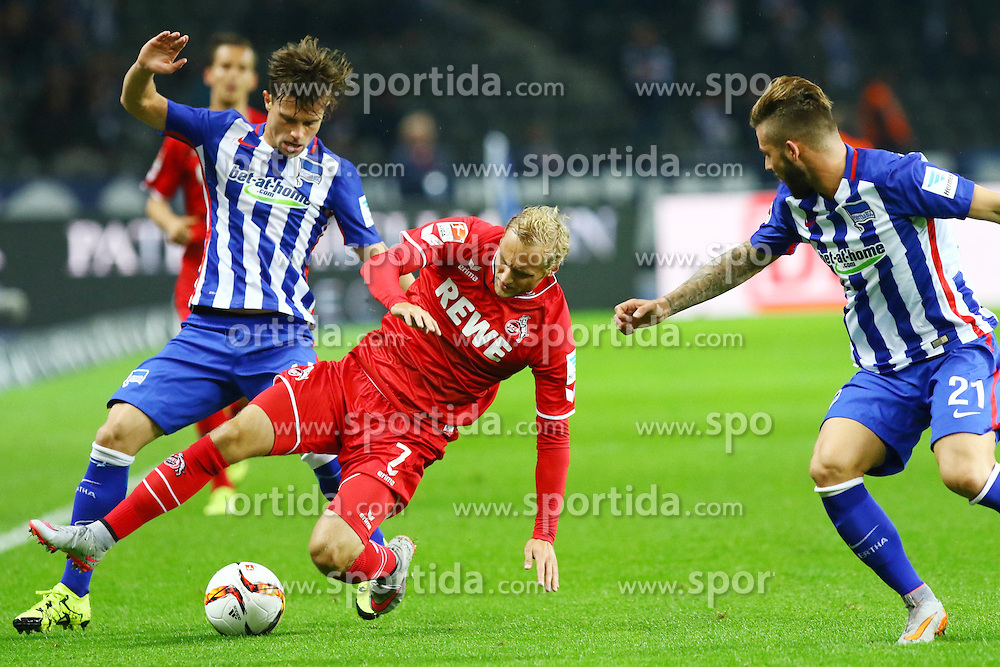 22.09.2015, Olympiastadion, Berlin, GER, 1. FBL, Hertha BSC vs 1. FC Koeln, 6. Runde, im Bild Zweikampf zwischen Valentin Stocker (#14, Hertha BSC Berlin) und Marcel Risse (#7, 1. FC Koeln) // during the German Bundesliga 6th round match between Hertha BSC and 1. FC Cologne at the Olympiastadion in Berlin, Germany on 2015/09/22. EXPA Pictures &copy; 2015, PhotoCredit: EXPA/ Eibner-Pressefoto/ Hundt<br /> <br /> *****ATTENTION - OUT of GER*****