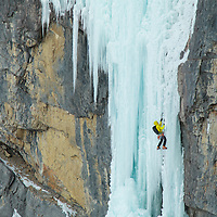 Jon Walsh leading up Oh Le Tabernac, WI5, ~60m along the Icefields Parkway in Alberta, Canada