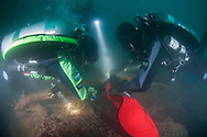 GUE (Global Underwater Explorers) divers attach a lift bag to an abandoned ghost net off Coronado island, San Diego, CA