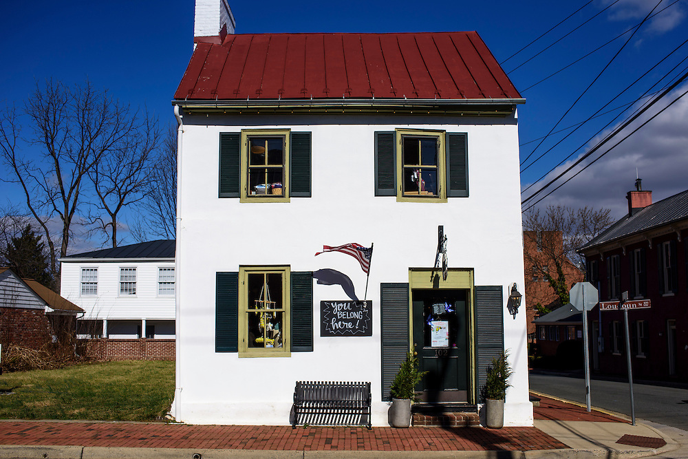 Leesburg, Virginia - February 13, 2017: An American Flag flies on the facade of Finch Knitting + Sewing Studio in Leesburg, Va., February 13, 2017. Under the flag is a board saying &quot;You Belong Here.&quot;<br /> <br /> Nicole Morgenthau, owner of Finch Knitting + Sewing Studio in Leesburg, Va., received a Pro-Trump email threatening a boycott of her store. She posted the note on her store's Facebook page. The response was an outpour of support for Morganthau and an increase in business.<br /> <br /> <br /> CREDIT: Matt Roth for The New York Times<br /> Assignment ID: 30202692A