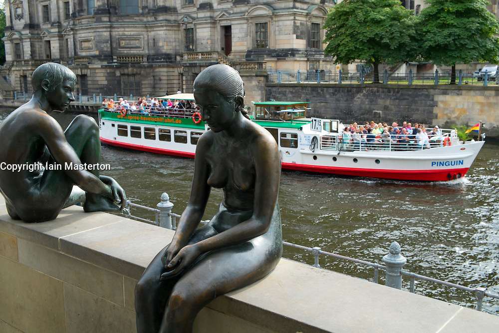 Bronze statues beside Spree River in Mitte district of Berlin Germany