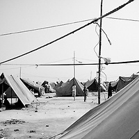 A view of one of the many camps for flood victims. Heavy monsoon rains displaced over 20 million people across Pakistan in the summer of 2010. The IDP's (Internally displaced people) now live in tents or schools used as temporary shelter and wait for the water to recede and return home to rebuild their lives. Karachi, Pakistan, 2010