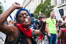 London, June 28th 2014. A marcher dances as the Pride London parade proceeds through the city's streets.