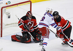 Feb 9, 2009; Newark, NJ, USA; New Jersey Devils goalie Scott Clemmensen (35) makes a save while New York Rangers right wing Colton Orr (28) and New Jersey Devils defenseman Andy Greene (6) battle during the second period at the Prudential Center.