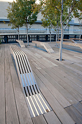 Wooden seating detail at  new High Line elevated landscaped public walkway built on old railway viaduct in Chelsea district of Manhattan in New York City USA