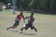 Camerson Sims (right) attends the Southern Elite Combine at FNC Park in Oxford, Miss. on Wednesday, July 10, 2013.