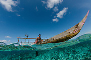 Local Papuan fisherman<br /> Half Island<br /> Cenderawasih Bay<br /> West Papua<br /> Indonesia<br /> Using spear and outrigger canoe