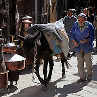 Africa, Morocco, Fes. Man with horse in Fes medina.