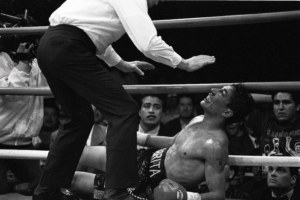 "Aljandro ""La Cobrita"" Gonzalez lies on canvas after being a knock out on the 4th round against Luisito Espinosa in Guadalajara, Mexico March 1, 1996."
