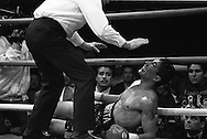 """Aljandro """"La Cobrita"""" Gonzalez lies on canvas after being a knock out on the 4th round against Luisito Espinosa in Guadalajara, Mexico March 1, 1996."""